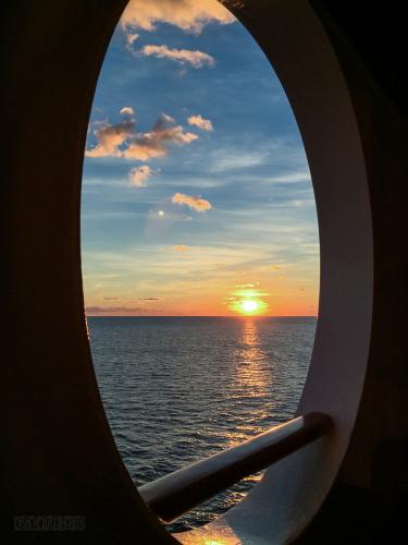 Porthole Sunrise Near Castaway Cay